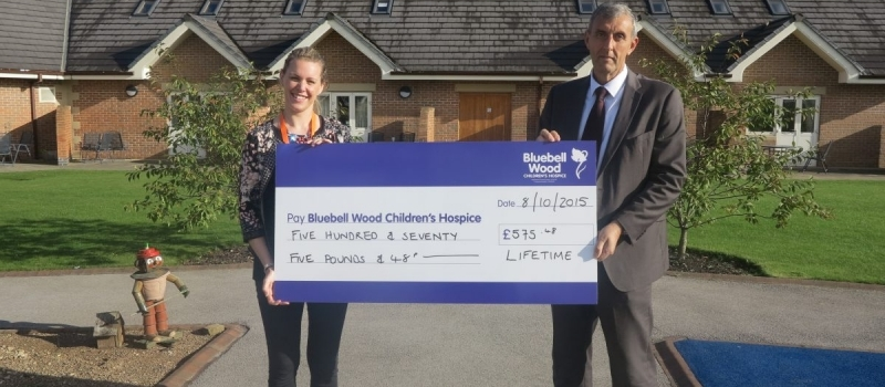 Lifetime financial planner Colin presents Bluebell Wood with bumper cheque