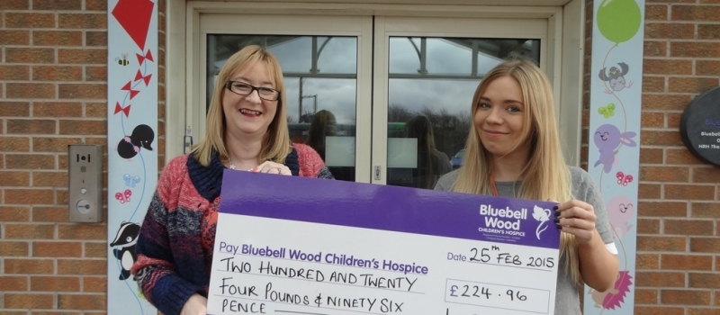 Lifetime financial planner Jan presents referral scheme cheque to Bluebell Wood