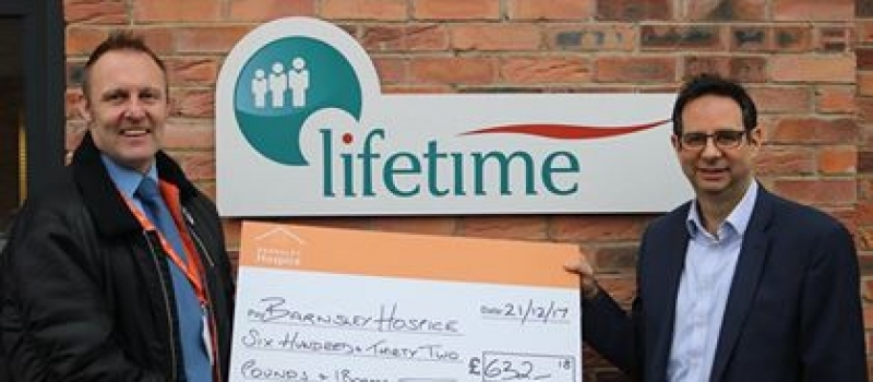 Hospice fundraiser Simon all smiles after receiving Lifetime referral scheme cheque